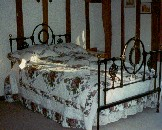 Antique black iron and brass bed