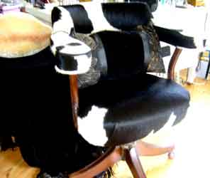 victorian office chair upholstered in cow hide