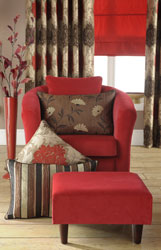 red velvet tub chair and foot stool