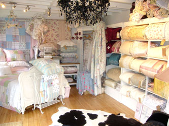 display of patchwork quilts and bedspreads