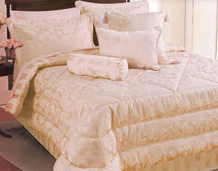 maison coral bedspread with matching duvet cover, cushions and curtains