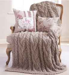 hand knit throw with cushions
